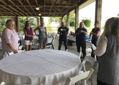 Golf 2021 Volunteers get their marching orders from Joy